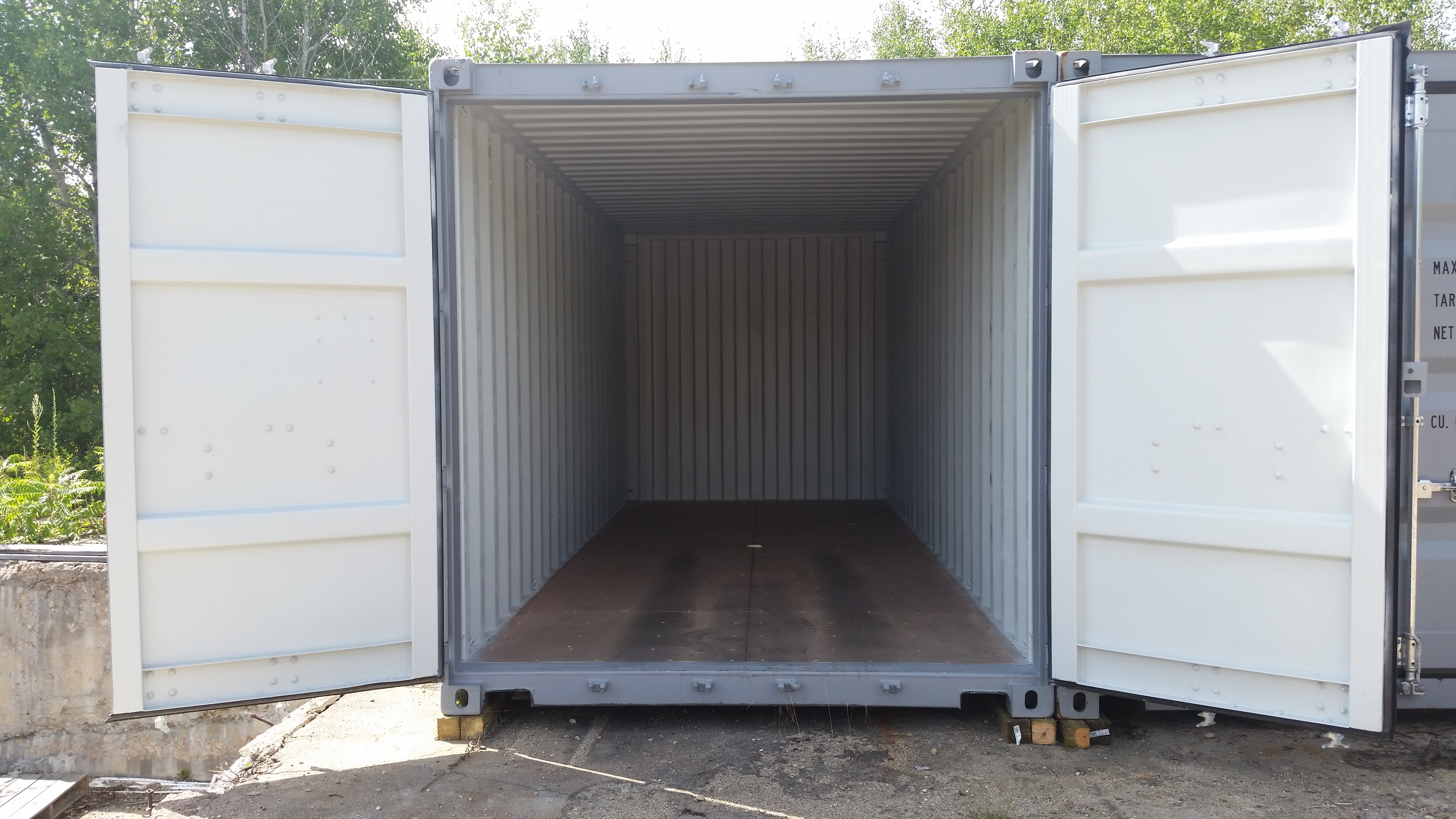 An empty storage container with its doors open